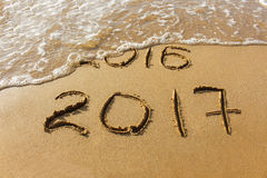 2016 and 2017 year written on  beach sea. Stock Image