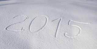 Year 2015 written over snow Royalty Free Stock Photos