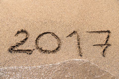 Year 2017 Written On Sand Royalty Free Stock Photos