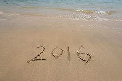 Year 2016 written in sand on beach Royalty Free Stock Images