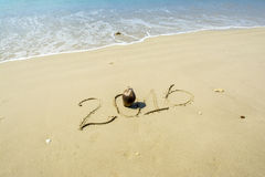 Year 2016 written in sand Stock Images