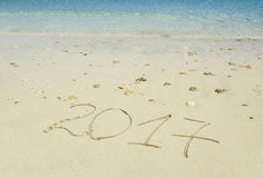 Year 2017 written in sand Royalty Free Stock Photography