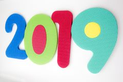 Year 2019 written with toddler toy numbers on white background stock images