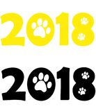 The year of the yellow dog. Two thousand and eighteenth year, the black and yellow colors. Dog tracks Royalty Free Stock Photography