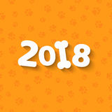 The year 2018 is a yellow earth dog. Cartoon figures. White bone. A pattern of yellow dog tracks. Cover for the calendar. Vector i. Happy New Year. The year 2018 Royalty Free Stock Photo