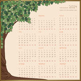 Yearly calendar 2014 in green tree frame. Full year calendar, names of months and dates are drawn manually Royalty Free Stock Photo