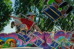 Yearly fair in Ouchy Lausanne. Children are happy in the carousel stock images