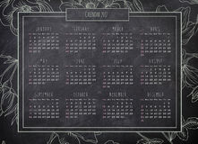 Yearly retro calendar blackboard background with green floral bo. 2017 yearly retro calendar on the blackboard background with mint green floral border stock illustration