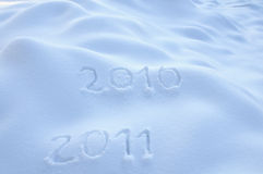 Years 2010 and 2011 in Snow. Years 2010 and 2011 written in Snow Stock Photos