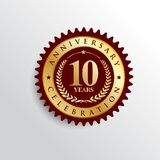 10 Years anniversary Golden badge logo. stock photography