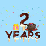 2 Years Anniversary celebration logo, with gift box and cake Stock Photography