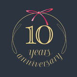 10 years anniversary celebration vector icon, logo. Template design element with golden number and red bow for 10th anniversary greeting card Stock Image
