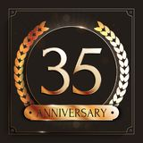 35 years anniversary gold banner on dark background. Stock Images