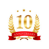 10 years anniversary golden label with ribbons. On a white background Royalty Free Stock Images