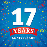 17 years anniversary logo celebration card. 17th years anniversary vector background with red ribbon and colored confetti on blue flash radial lines vector illustration