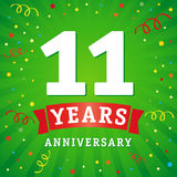 11 years anniversary logo celebration card. 11th years anniversary vector background with red ribbon and colored confetti on green flash radial lines Royalty Free Stock Images