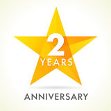 2 years anniversary star logo. 2th years anniversary golden vector sign facet star isolated on white background Stock Photography