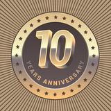 10 years anniversary vector icon, logo. Graphic design element or emblem as a golden medal for 10th anniversary Royalty Free Stock Photos