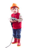 Baby in hardhat with drill. Royalty Free Stock Images