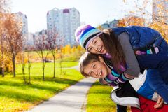 10 years boy carry girl Stock Images