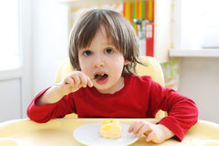 2 years boy eating scrambled eggs. Healthy nutrition Royalty Free Stock Photos