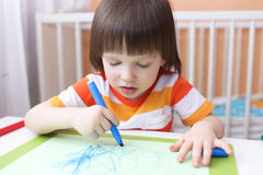 3 years boy with felt pens. Cute little 3 years boy paints with felt pens Stock Photos