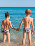 6-7 years boys in front of sea hand in hand Royalty Free Stock Image