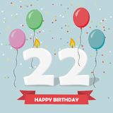 22 years celebration. Happy Birthday greeting card. With candles, confetti and balloons Stock Photography
