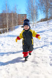 2 years child in overall running in winter Royalty Free Stock Photos