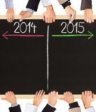 Years concept. Photo of business hands holding blackboard and writing timeline with 2014 and 2015 years stock photo
