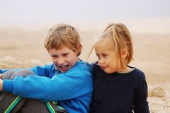 5 years girl with her autistic 8 years old brother royalty free stock images