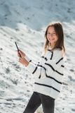 11 years girl with tablet pc making selphie against a sand hill. close up royalty free stock photo