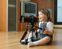 2 years  girl takes photo with camera Stock Photo