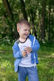 Active kid playing in the garden on a sunny summer day, Out doors activities for children. 4 years Little boy with soap bubbles in summer green trees park, funny stock image
