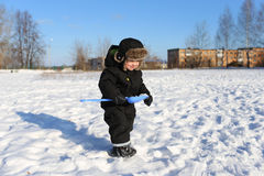 2 years little boy walking with shovel in winter Royalty Free Stock Photo