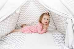 2 years little girl in wigwam tent at home. 2 years little girl in wigwam tent Stock Photo