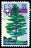 150 Years Michigan Statehood, White Pine next to Sun Set, serie, circa 1987. MOSCOW, RUSSIA - MARCH 23, 2019: Postage stamp printed in United States shows 150 stock photos