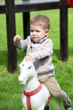2 years old Baby boy playing with horse Royalty Free Stock Photos