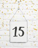 15 years old birthday party card with number fifteen with golden. 15 years old birthday party card text with golden confetti, number fifteen, metal plate white stock images