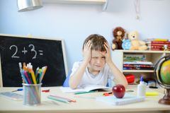 7 years old boy doing his homework Stock Photos