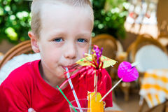 5 years old boy drinking a cocktail Royalty Free Stock Images
