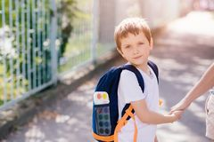 7 years old boy going to school with his mother Royalty Free Stock Image