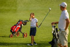The boy practice golf hits at golf course stock photography