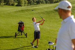 11 years old boy practice golf hits at golf course royalty free stock images