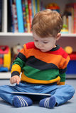 2 years old boy using a digital tablet computer Royalty Free Stock Image