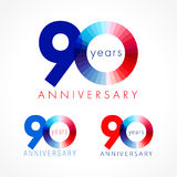 90 years old celebrating colored logo. Anniversary numbers 90 th. Shining congratulating logotype. Greetings celebrates set red, blue, white colors. Stained Stock Photo