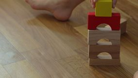 3 years old child boy play with wooden blocks, build house at home. Three years old child boy play with wooden blocks, build house at home. Educational toys for stock footage