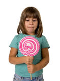 4 or 5 years old child girl eating big pink lollipop candy isolated on white background Royalty Free Stock Photos