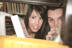A 20 years old couple student studying. Check something throw a book row Royalty Free Stock Images
