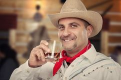 Cowboy is enjoying neat whiskey stock photography